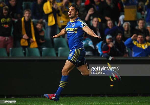 Jarryd Hayne of the Eels celebrates after scoring a try during the round 13 NRL match between the Parramatta Eels and the Cronulla Sharks at...