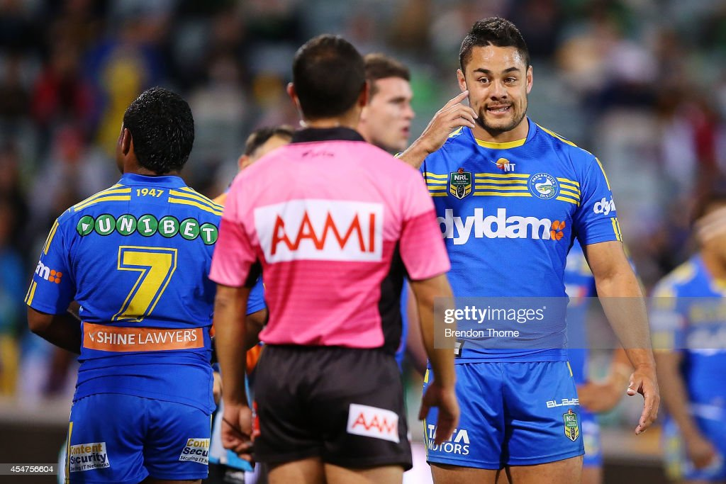 Jarryd Hayne of the Eels gestures towards referee, Ashley Klein during the round 26 NRL match between the Canberra Raiders and the Parramatta Eels at GIO Stadium on September 6, 2014 in Canberra, Australia.