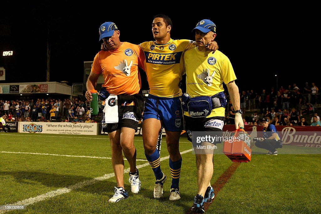 Jarryd Hayne of the Eels is assisted off the field after an injury during the NRL trial match between the Penrith Panthers and the Parramatta Eels at Centrebet Stadium on February 17, 2012 in Sydney, Australia.