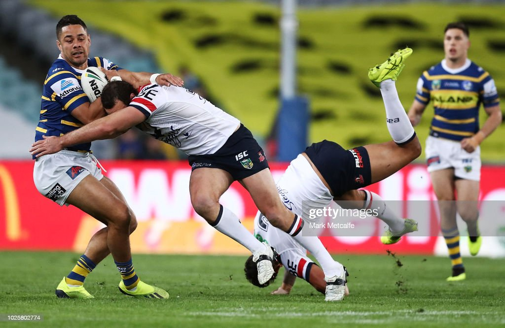 Jarryd Hayne of the Eels is tackled by Boyd Cordner of the Roosters during the round 25 NRL match between the Parramatta Eels and the Sydney Roosters at ANZ Stadium on September 1, 2018 in Sydney, Australia.