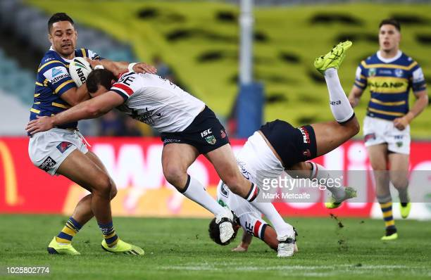 Jarryd Hayne of the Eels is tackled by Boyd Cordner of the Roosters during the round 25 NRL match between the Parramatta Eels and the Sydney Roosters...