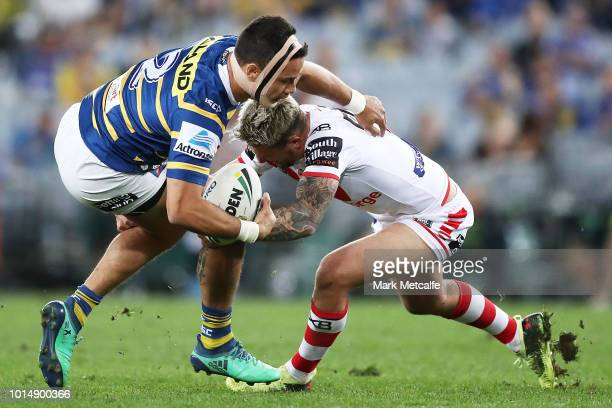Jarryd Hayne of the Eels is tackled by Gareth Widdop of the Dragons during the round 22 NRL match between the Parramatta Eels and the St George...