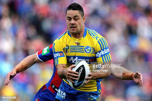 Jarryd Hayne of the Eels is tackled by the Knights defence during the round 25 NRL match between the Newcastle Knights and the Parramatta Eels at...