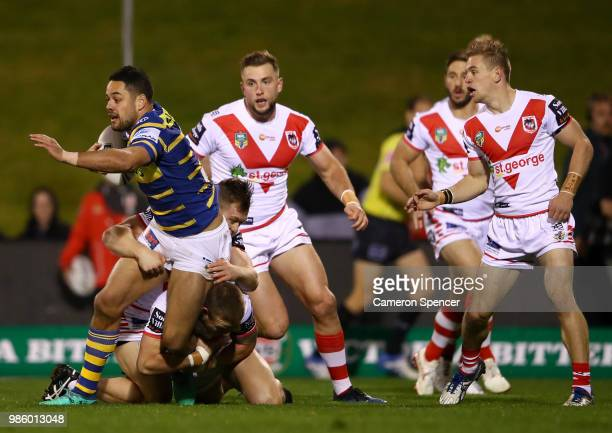 Jarryd Hayne of the Eels is tackled during the round 16 NRL match between the St George Illawarra Dragons and the Parramatta Eels at WIN Stadium on...