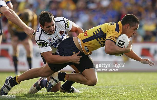 Jarryd Hayne of the Eels is tackled during the round 25 NRL match between the Parramatta Eels and the Brisbane Broncos at Parramatta Stadium August...