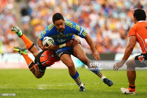 Jarryd Hayne of the Eels is tackled during the round seven NRL match between the Parramatta Eels and the Wests Tigers at ANZ Stadium on April 21 2014...