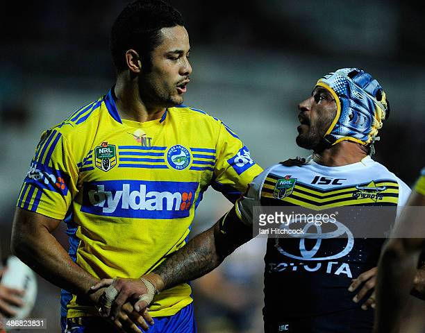 Jarryd Hayne of the Eels tussles with Johnathan Thurston of the Cowboys during the round 8 NRL match between the North Queensland Cowboys and the...