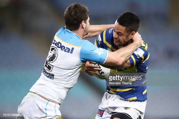 Jarryd Hayne of the Eelsis tackled by Anthony Don of the Titans during the round 21 NRL match between the Parramatta Eels and the Gold Coast Titans...