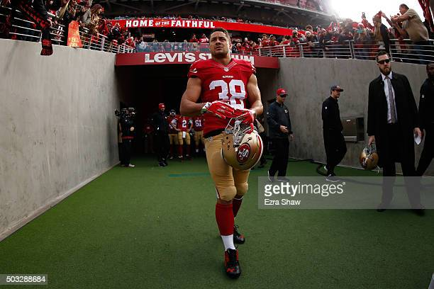 Jarryd Hayne of the San Francisco 49ers walks onto the field against the St Louis Rams prior to their NFL game at Levi's Stadium on January 3 2016 in...