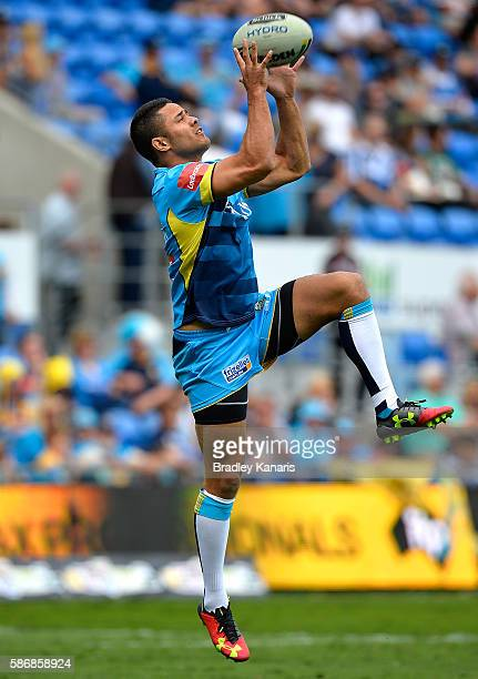 Jarryd Hayne of the Titans catches the ball during the team warm ups before the round 22 NRL match between the Gold Coast Titans and the New Zealand...