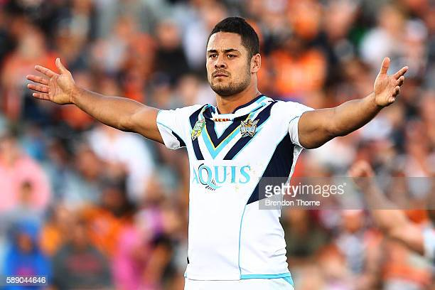 Jarryd Hayne of the Titans celebrates after kicking a drop goal to win the match during the round 23 NRL match between the Wests Tigers and the Gold...