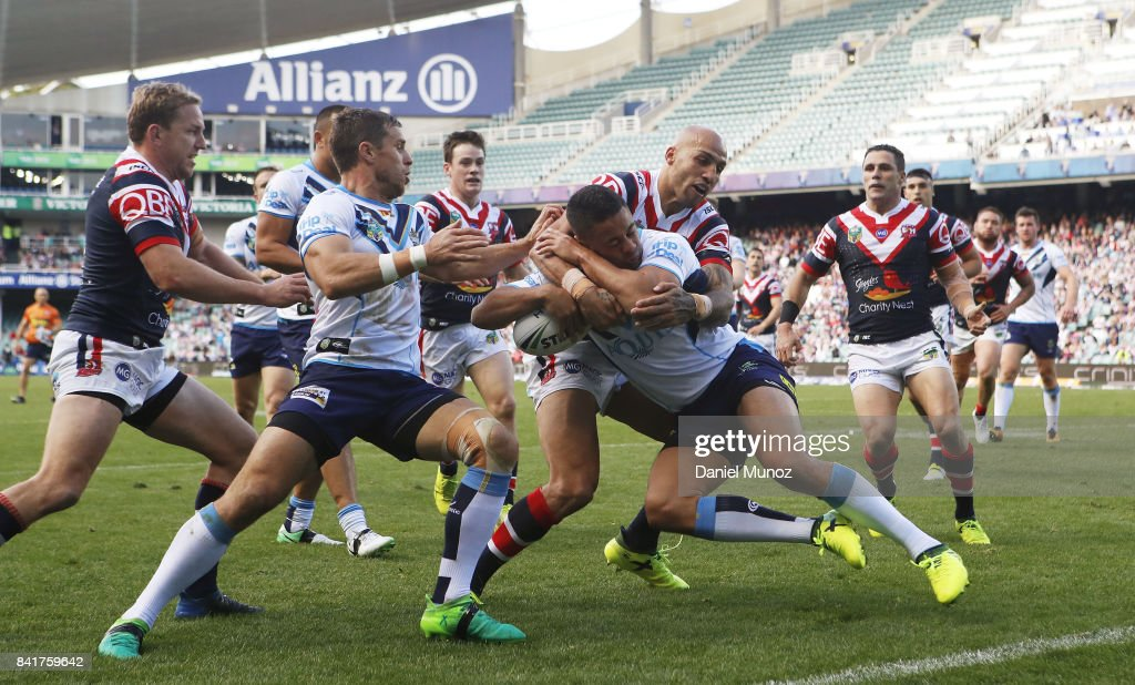 Jarryd Hayne of the Titans is tackled by Blake Ferguson of the Roosters during the round 26 NRL match between the Sydney Roosters and the Gold Coast Titans at Allianz Stadium on September 2, 2017 in Sydney, Australia.