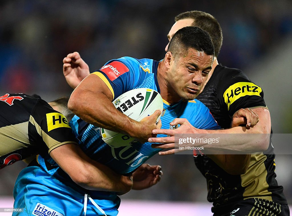 Jarryd Hayne of the Titans is tackled by Isaah Yeo of the Panthers during the round 25 NRL match between the Gold Coast Titans and the Penrith Panthers at Cbus Super Stadium on August 27, 2016 in Gold Coast, Australia.