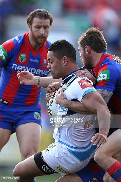 Jarryd Hayne of the Titans is tackled during the round 24 NRL match between the Newcastle Knights and the Gold Coast Titans at Hunter Stadium on...