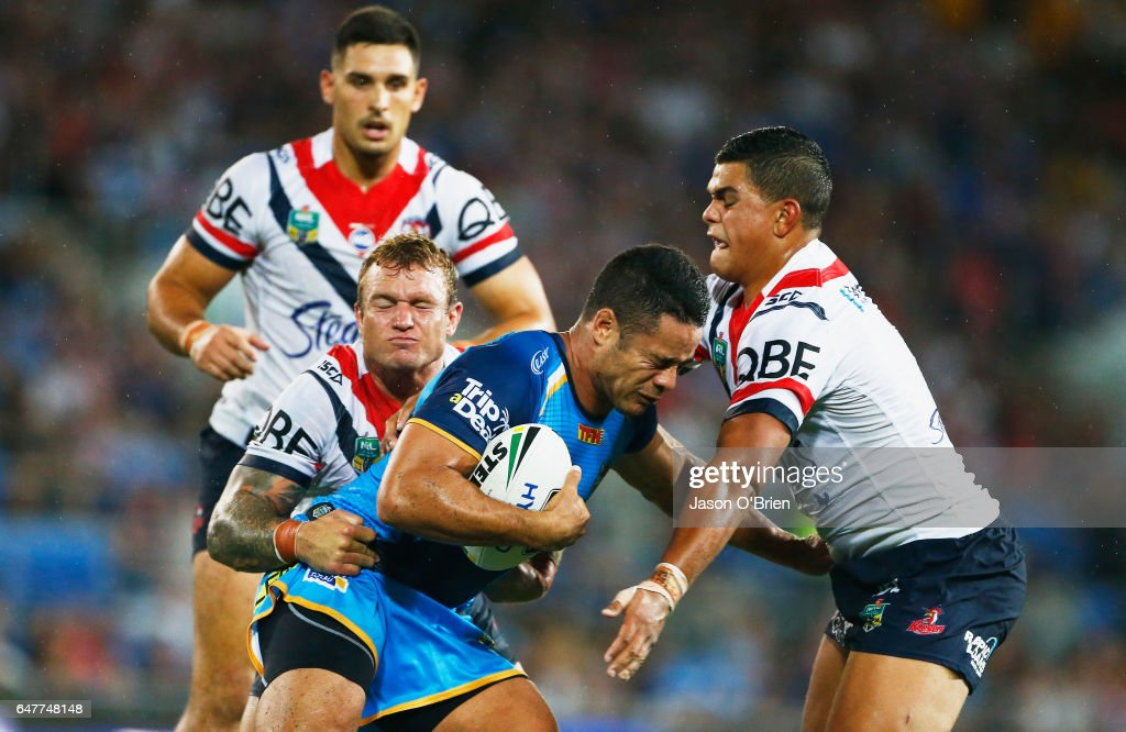 Jarryd Hayne of the Titans is tackled during the round one NRL match between the Gold Coast Titans and the Sydney Roosters at Cbus Super Stadium on March 4, 2017 in Gold Coast, Australia.