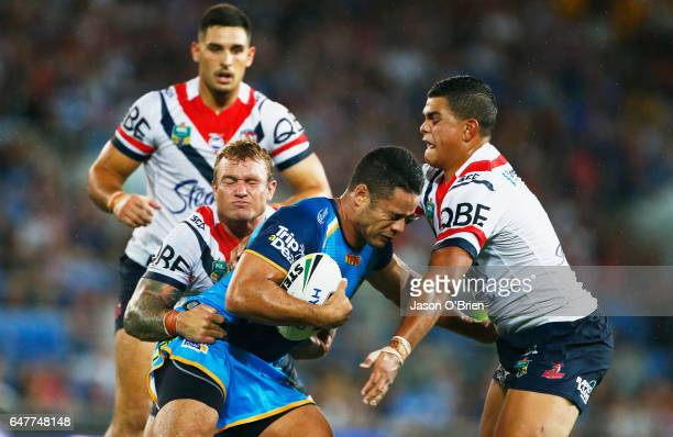 Jarryd Hayne of the Titans is tackled during the round one NRL match between the Gold Coast Titans and the Sydney Roosters at Cbus Super Stadium on...