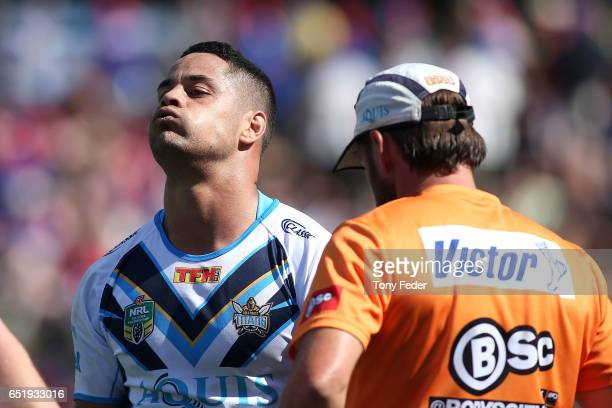 Jarryd Hayne of the Titans leaves the ground after sustaining an injury during the round two NRL match between the Newcastle Knights and the Gold...