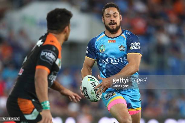 Jarryd Hayne of the Titans runs the ball during the round 21 NRL match between the Gold Coast Titans and the Wests Tigers at Cbus Super Stadium on...