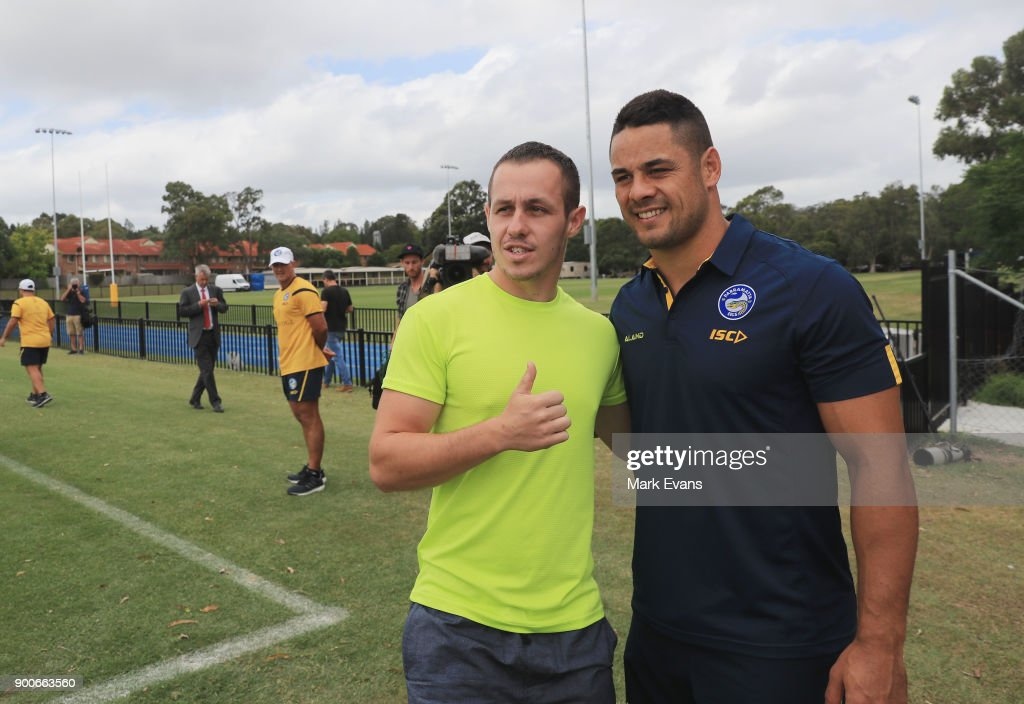 Jarryd Hayne poses for a photo with a fan after holding a press conference at Parramatta Eels training at Old Saleyards Reserve on January 3, 2018 in Sydney, Australia.