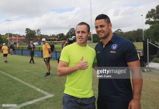 Jarryd Hayne poses for a photo with a fan after holding a press conference at Parramatta Eels training at Old Saleyards Reserve on January 3 2018 in...