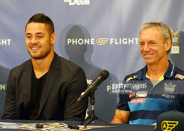 Jarryd Hayne with Titans coach Neil Henry during a press conference at Gold Coast Airport on August 3 2016 in Gold Coast Australia