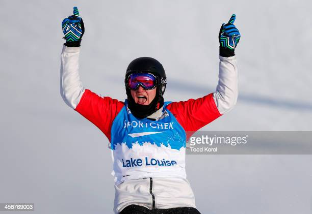 Jarryd Hughes of Australia celebrates his win during the men's finals at the FIS Snowboard Cross World Cup December 21 2013 in Lake Louise Alberta...
