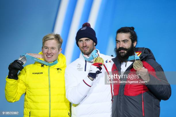 Jarryd Hughes of Australia wins the silver medal Pierre Vaultier of France wins the gold medal Regino Hernandez of Spain wins the bronze medal during...
