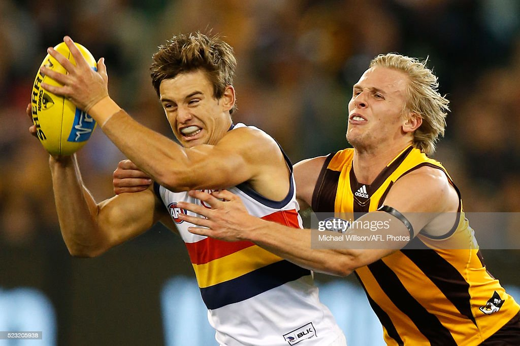 Jarryd Lyons of the Crows is tackled by Will Langford of the Hawks during the 2016 AFL Round 05 match between the Hawthorn Hawks and the Adelaide Crows at the Melbourne Cricket Ground on April 22, 2016 in Melbourne, Australia.