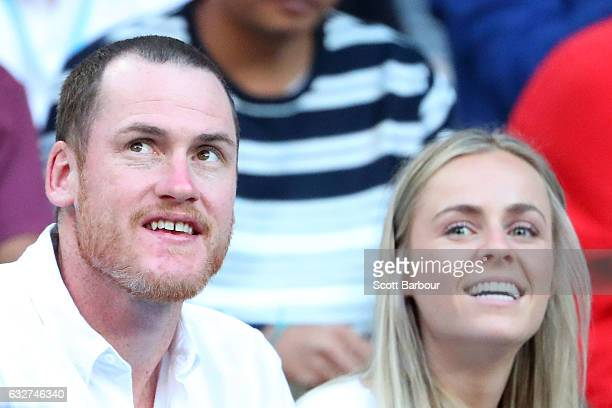 Jarryd Roughead and Sarah Dunn watch the semifinal match between Roger Federer of Switzerland and Stan Wawrinka of Switzerland on day 11 of the 2017...