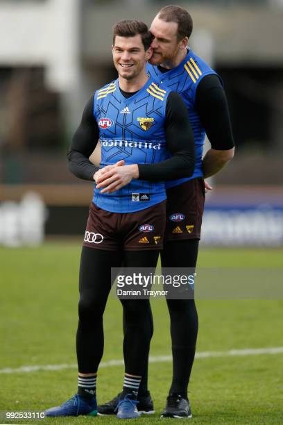 Jarryd Roughead gets in the ear of Jaeger O'Meara during a Hawthorn Hawks AFL Training Session at Waverley Park on July 6 2018 in Melbourne Australia