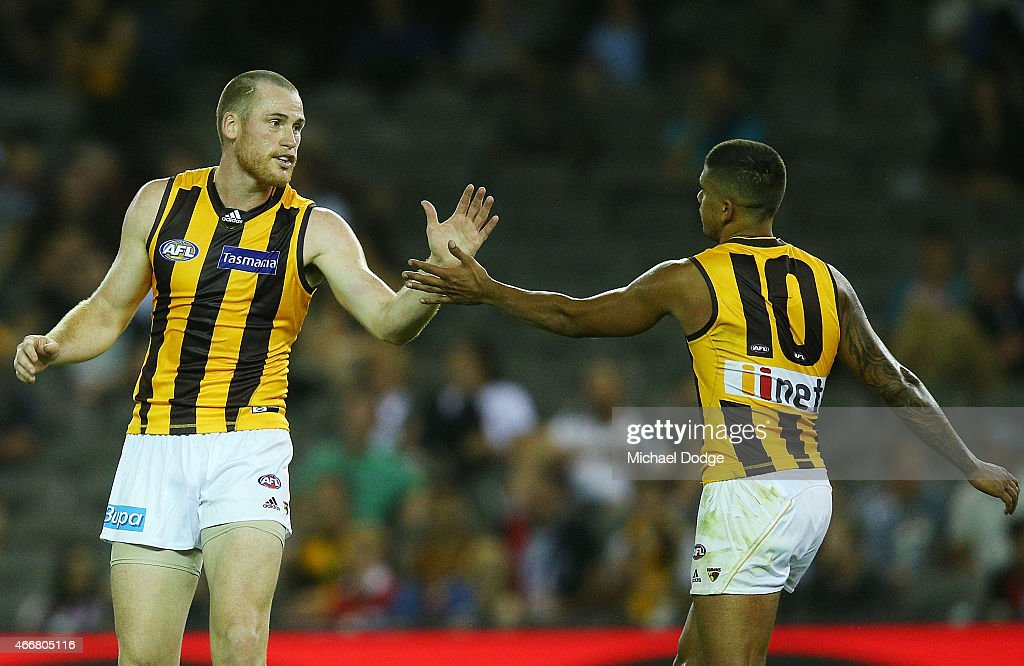 Jarryd Roughead of the Hawks and Bradley Hill (R) celebrate a goal during the NAB Challenge AFL match between St Kilda Saints and Hawthorn Hawks at Etihad Stadium on March 19, 2015 in Melbourne, Australia.