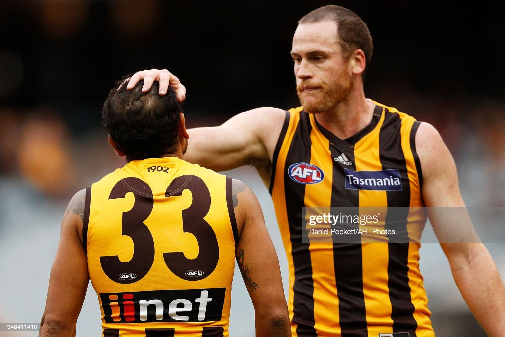 Jarryd Roughead of the Hawks and Cyril Rioli of the Hawks celebrate a goal during the round four AFL match between the Hawthorn Hawks and the Melbourne Demons at Melbourne Cricket Ground on April 15, 2018 in Melbourne, Australia.