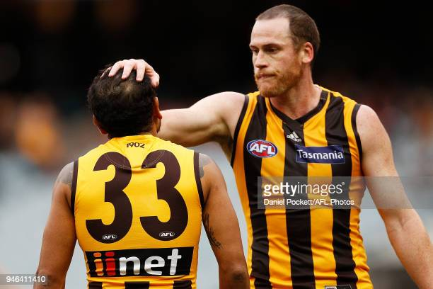 Jarryd Roughead of the Hawks and Cyril Rioli of the Hawks celebrate a goal during the round four AFL match between the Hawthorn Hawks and the...