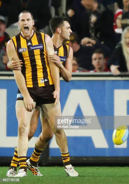 Jarryd Roughead of the Hawks and Jack Gunston of the Hawks celebrate a goal during the round 18 AFL match between the Hawthorn Hawks and the Sydney...