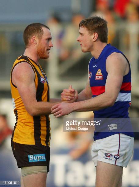 Jarryd Roughead of the Hawks and Jordan Roughead of the Bulldogs shake shakes after the round 17 AFL match between the Hawthorn Hawks and the Western...