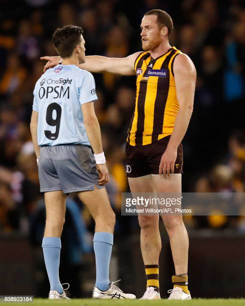 Jarryd Roughead of the Hawks and Umpire Matt Stevic share a discussion during the 2017 AFL round 23 match between the Hawthorn Hawks and the Western...