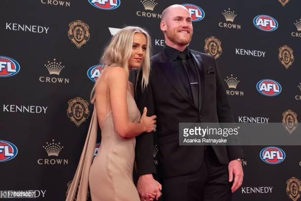 Jarryd Roughead of the Hawks arrives wife his wife Sarah Roughead arrives ahead of the 2019 Brownlow Medal at Crown Palladium on September 23 2019 in...