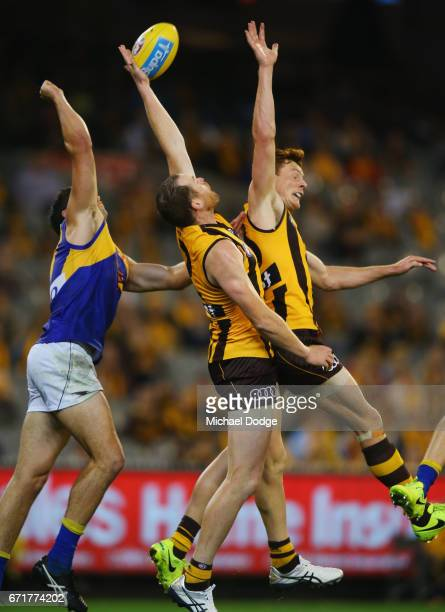 Jarryd Roughead of the Hawks compete for the ball against Jeremy McGovern of the Eagles and next to teammate Tim O'Brien of the Hawks during the...