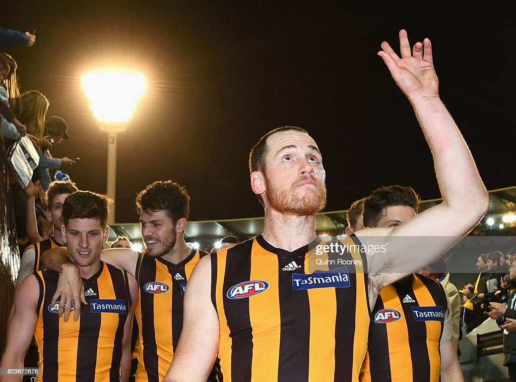 Jarryd Roughead of the Hawks high fives fans after winning the round 19 AFL match between the Hawthorn Hawks and the Sydney Swans at Melbourne Cricket Ground on July 28, 2017 in Melbourne, Australia.