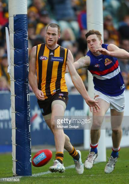 Jarryd Roughead of the Hawks kicks a goal against Jordan Roughead of the Bulldogs during the round 17 AFL match between the Hawthorn Hawks and the...