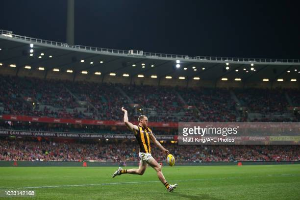 Jarryd Roughead of the Hawks kicks during the round 23 AFL match between the Sydney Swans and the Hawthorn Hawks at Sydney Cricket Ground on August...