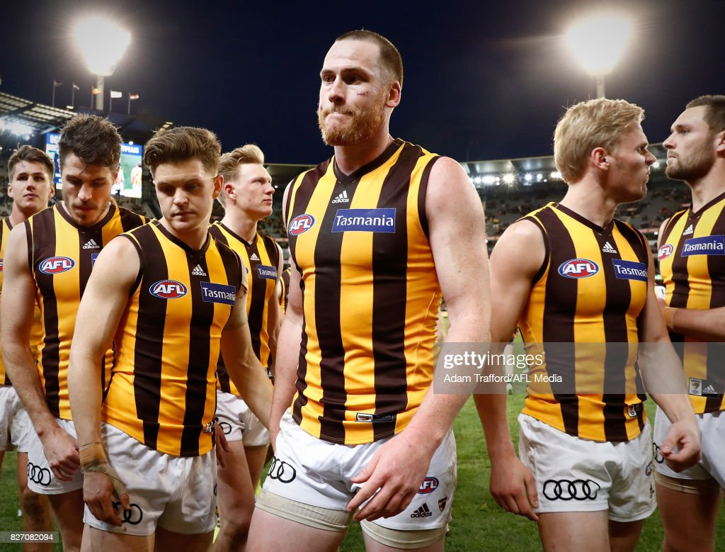 Jarryd Roughead of the Hawks leads the team off after his 250th game during the 2017 AFL round 20 match between the Richmond Tigers and the Hawthorn Hawks at the Melbourne Cricket Ground on August 06, 2017 in Melbourne, Australia.