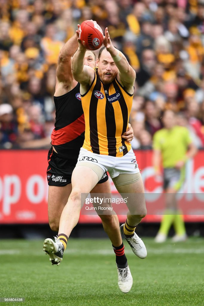 Jarryd Roughead of the Hawks marks infront of Cale Hooker of the Bombers during the round seven AFL match between the Essendon Bombers and the Hawthorn Hawks at Melbourne Cricket Ground on May 5, 2018 in Melbourne, Australia.