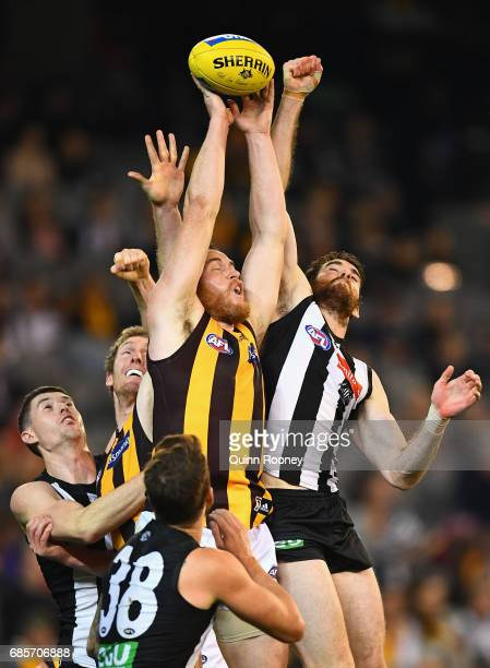 Jarryd Roughead of the Hawks marks infront of Tyson Goldsack of the Magpies during the round nine AFL match between the Collingwood Magpies and the...