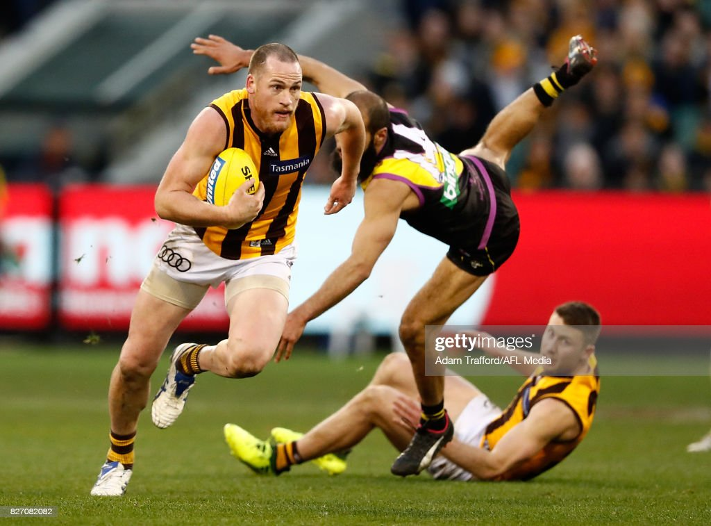 Jarryd Roughead of the Hawks playing his 250th game evades Bachar Houli of the Tigers during the 2017 AFL round 20 match between the Richmond Tigers and the Hawthorn Hawks at the Melbourne Cricket Ground on August 06, 2017 in Melbourne, Australia.