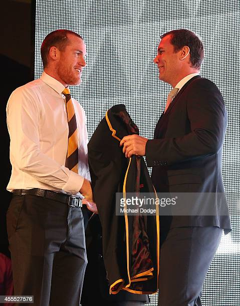 Jarryd Roughead of the Hawks receives his blazer from Wayne Carey after being announced in the All Australian Team Announcement at Royal Exhibition...