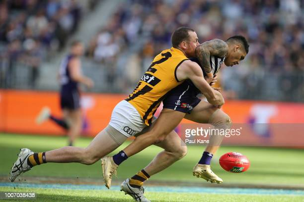 Jarryd Roughead of the Hawks tackles Michael Walters of the Dockers during the round 19 AFL match between the Fremantle Dockers and the Hawthorn...