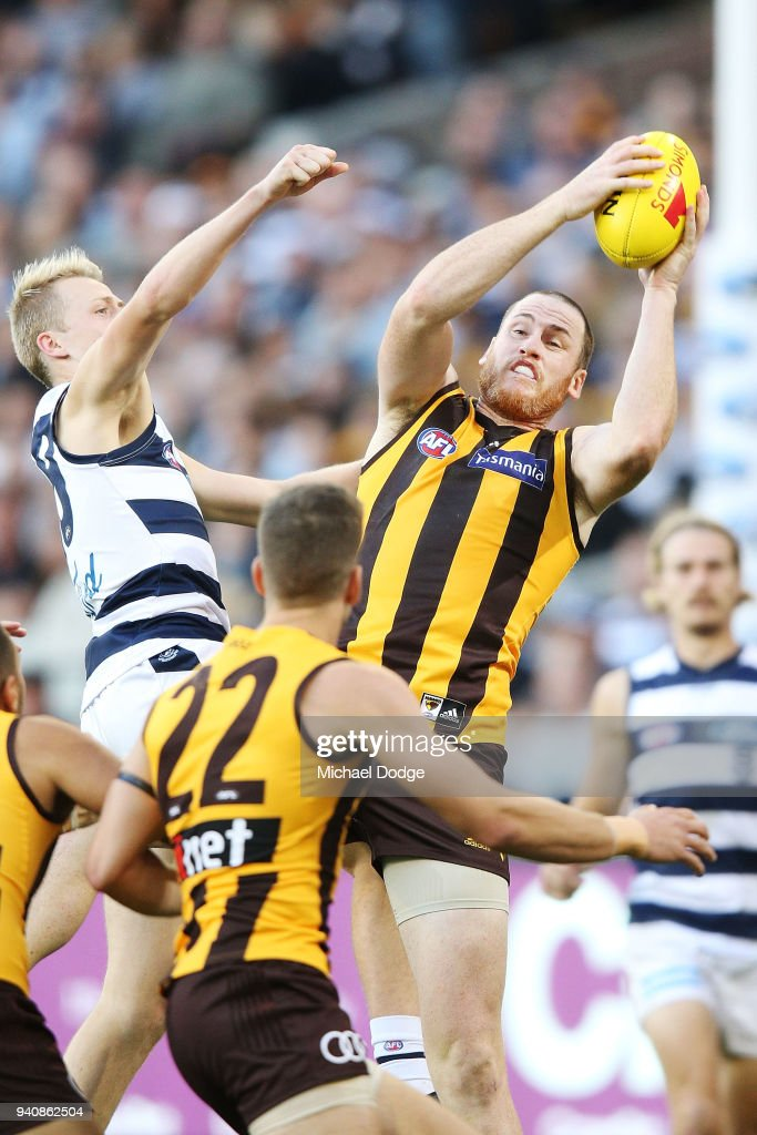 Jarryd Roughed of the Hawks marks the ball against Zach Guthrie of the Cats during the round two AFL match between the Geelong Cats and the Hawthorn Hawks at Melbourne Cricket Ground on April 2, 2018 in Melbourne, Australia.