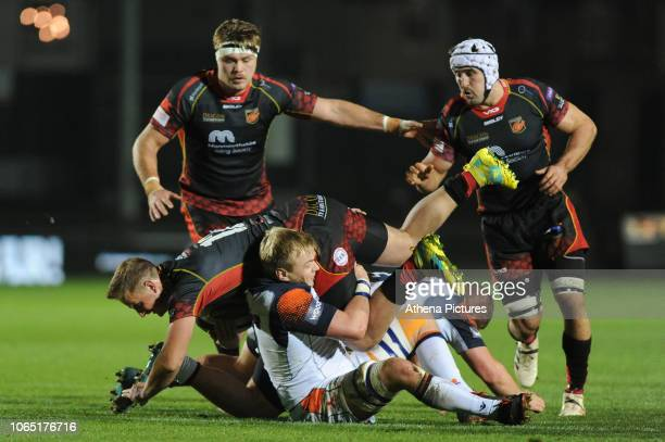 Jarryd Sage of Dragons is tackled by Luke Hamilton of Edinburgh during the Guinness Pro14 Round 09 match between the Dragons and Edinburgh at Rodney...