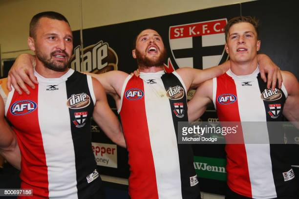 Jarryn Geary Jack Steven and Jack Newnes sing the club song after winning during the round 14 AFL match between the St Kilda Saints and the Gold...